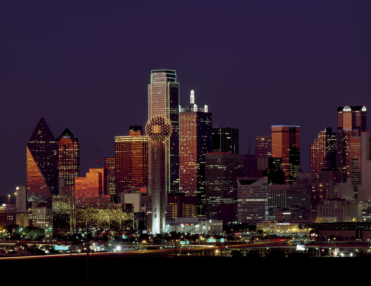 The Dallas skyline of high-rise buildings at night