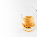 A clear glass with whiskey