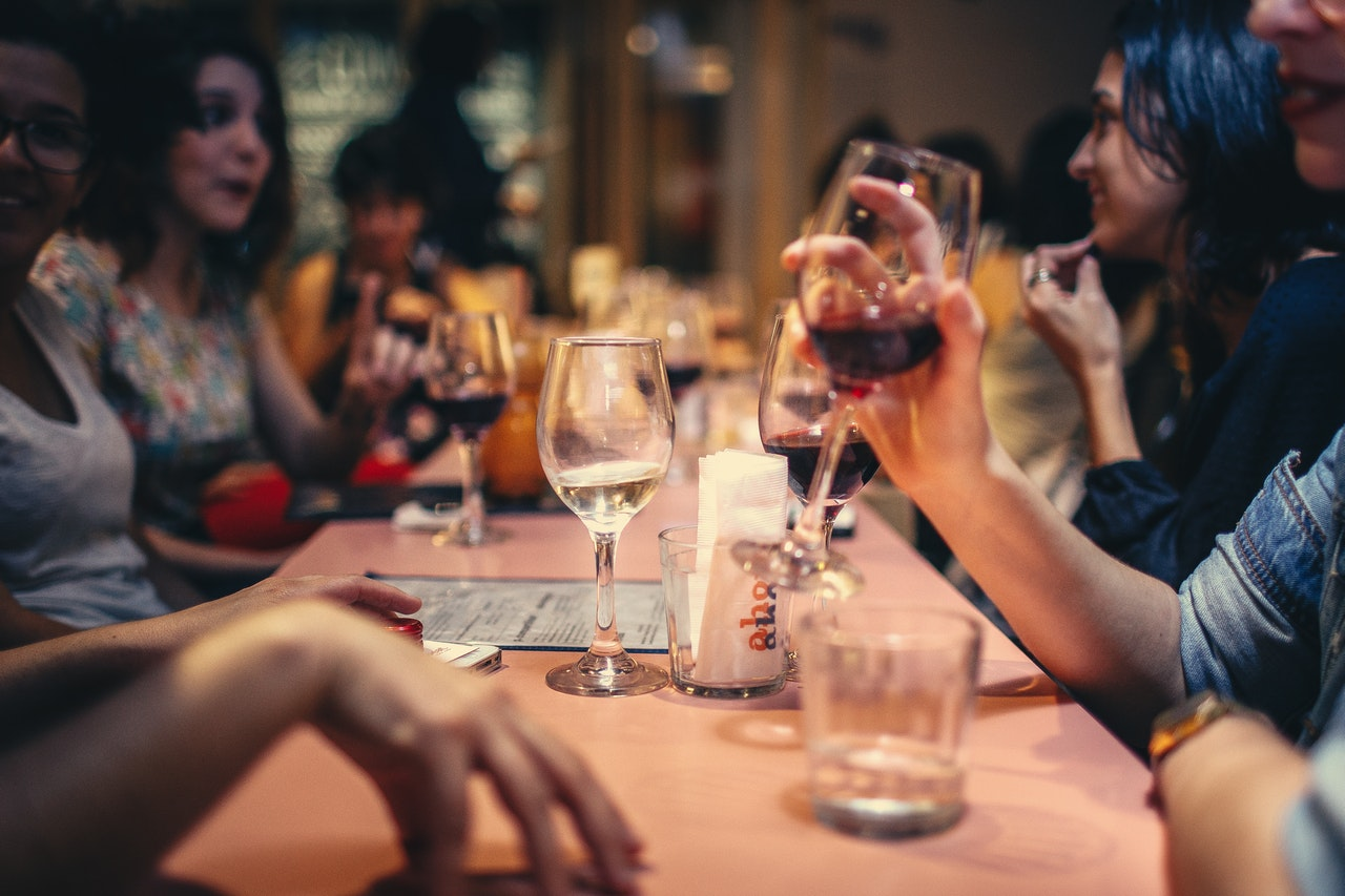 Friends enjoy wine at a winery