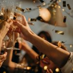 People toasting glasses on New Years Eve