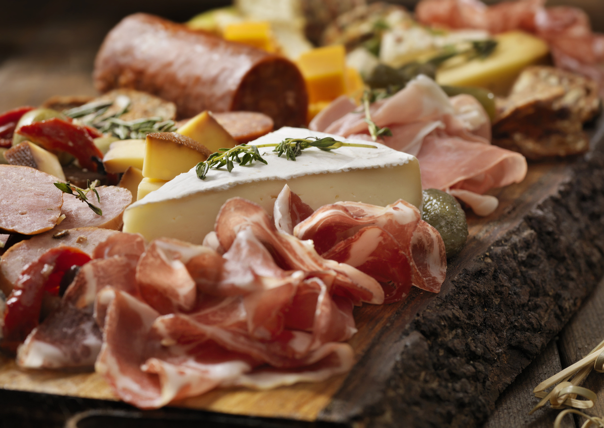 A cheese board of meats and cheeses.