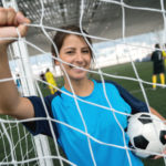 A soccer player holding the ball on an indoor soccer field | indoor soccer in Dallas, TX